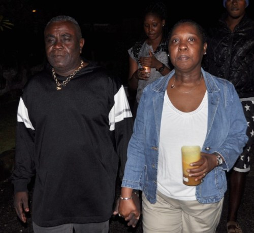 The deceased's father Kenrick Murrell (left) and mother Lorraine Selman at the vigil in honour of their late son.