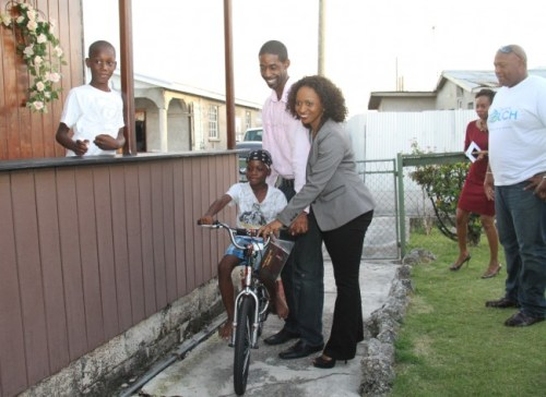 Xavier Bertrand on his new bicycle, as brother Nequon (at left) looks on. Others are Prestige Accounting Inc. head David Simpson, BT's CEO Kaymar Jordan, Cave Shepherd's Kay Richards and BT Sales Manager David Williams.