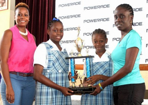 Banks category manager Shelly Phillips (left) made the presentation to the Springer Memorial School. At right is the school's coach Julie Phillips, Khadeja Straughan (second right) and Julisa Jones-Smith.