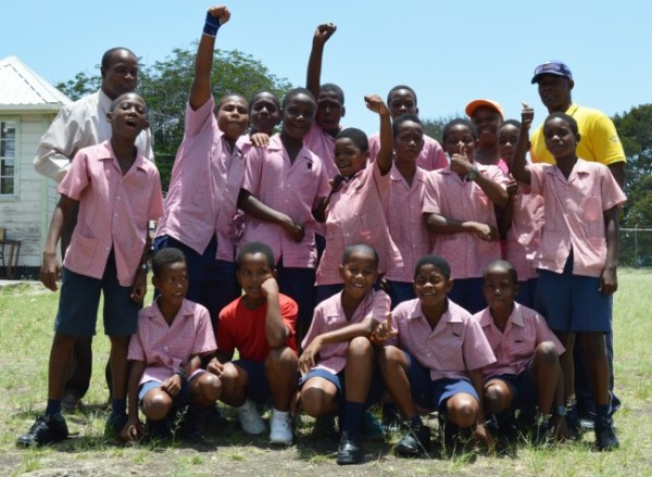 Charles F. Broomes principal Louis Griffith and physical education teacher Alphonza King with members of the school's cricket team.