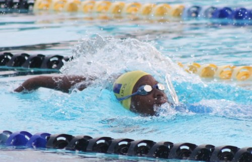Danielle Titus does the backstroke during her win in the 11-12 girls 200m individual medley.