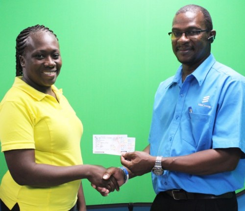 Robert Deane collecting prize on behalf of his wife Tonya Deane (winner of Barbados TODAY'S Scribe And Drive Sweepstakes 2014).