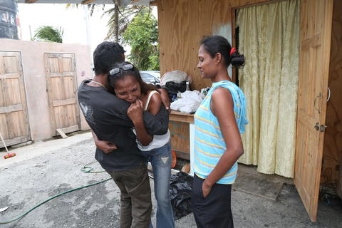 Lynette Ragbirsingh being consoled outside her home, from which she said she is being evicted.