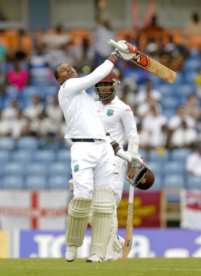 Marlon Samuels celebrates his 7th Test century but was dismissed soon afterwards.
