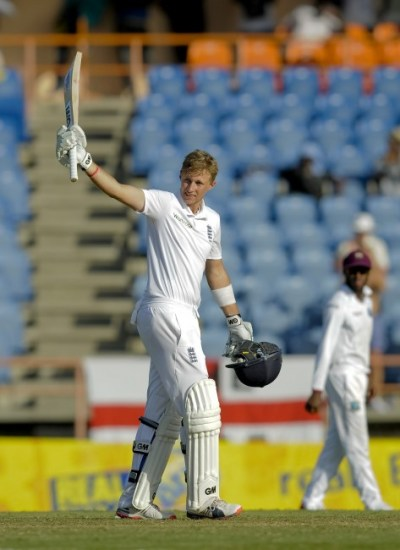 Joe Root acknowledges the crowd on reaching his century.