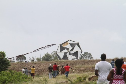 An attempt being made to hoist one of the massive kites.