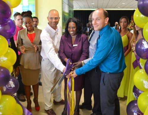 From right front, Chefette Restaurants managing director Ryan Haloute cutting the ribbon with employees Terel Hunte, Gail-Ann Cumberbatch and Maurice Habre, as marketing officer Marquest Clarke-Griffith looks on.