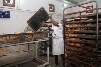 Nicholls Bakery's Vanita Inniss preparing bread for Easter.