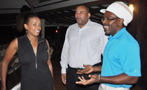 Minister Richard Sealy (centre) and musician  Nicholas Brancker (right) were in attendance.