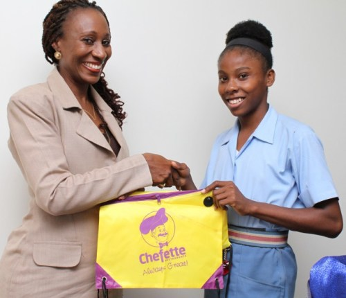 Chefette Restaurants' marketing officer  Marquest Clarke-Griffith congratulated Mary Fraser, The Most Outstanding Athlete for her three CARIFTA gold medals.