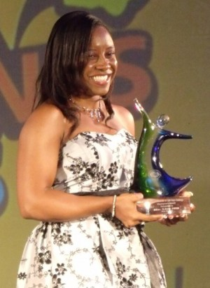 Lisa Ifill poses with her Private Sector Champion's Award.
