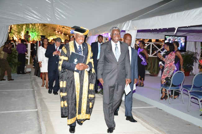 Chancellor of the UWI Sir George Alleyne and Prime Minister Freundel Stuart lead the procession of officials.