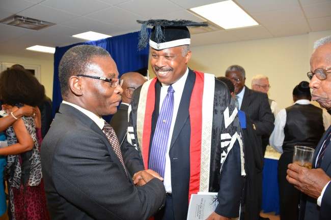 Housing Minister Denis Kellman was also in attendance. Here he is warmly greeted by Sir Hilary.