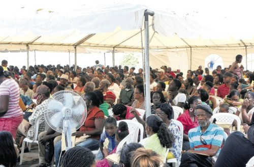 These passport applicants were among the 'lucky' ones who were admitted to have documents processed yesterday. Scores were turned back because of a quota system.