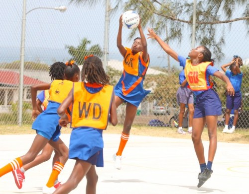 Vauxhall goal-keeper Aanyah Cox is composed as she makes the catch despite efforts from St Christopher's goal-defence Candace Farrell to make an interception.
