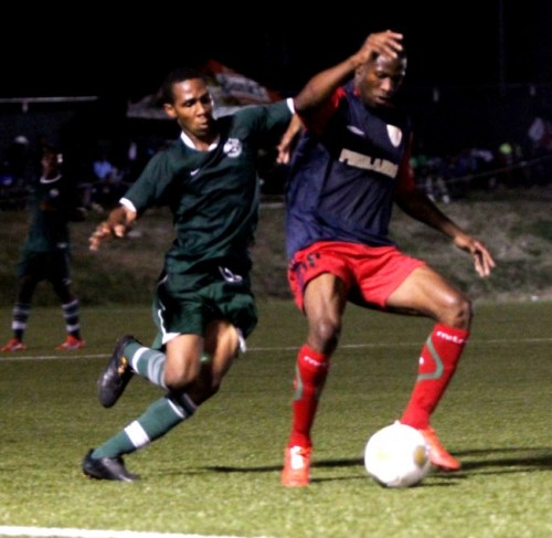 Wales' goal scorer Kemar Headley (left) pursues the ball while Arantees Lawrence of Pinelands tries to  control it.