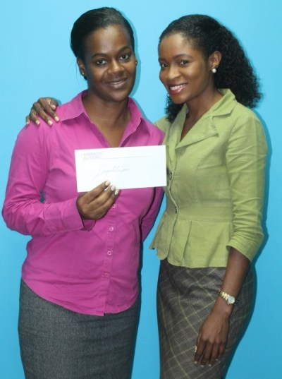 Janelle Marshall accepting prize from BT Account Executive Omisa Hobbs.