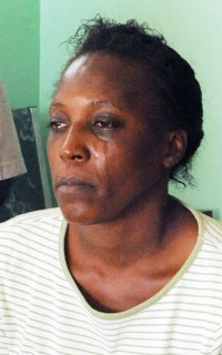 Sister Jennifer Rudder crying over the loss of her sibling.
