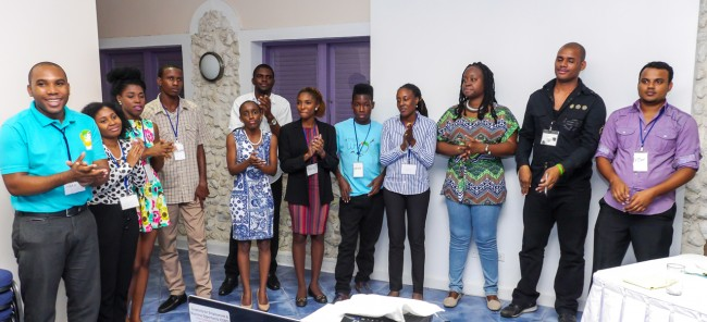 The 12 young entrepreneurs who have advanced in the Caribbean Call To Action Entrepreneurship Challenge  (from left): Willan Mark of Grenada, Shamoy Hajare of Jamaica, Nikele Davis of Barbados, Magaran Joseph of St Lucia, Janice McLeod of Jamaica, Joshua Forte of Barbados, Jenell Pierre of Guyana, Devin Odlum of Antigua and Barbuda, Josanne Arnold and Korice Nancis of both of Trinidad and Tobago, Vincent Polak of Suriname, and Vijay Dialsingh  of Trinidad and Tobago.