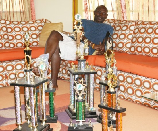 Wednesday 2000 bandleader Mackie Holder displaying a few of the many trophies he has won over the last 21 years.