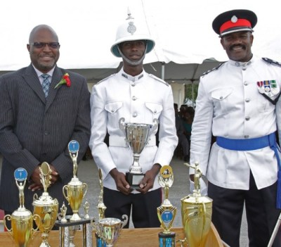 Attorney General Adriel Brathwaite (left) the Regional Police Training Centre's Commandant Sylvester Louis (right) enjoying a proud moment with Best Recruit Eleazar Williams.