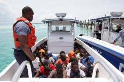 A Defence Force boat carries some of the illegal immigrants held in Exuma on Wednesday.