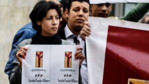 Activist Shaimaa al-Sabbagh holds up a poster at a protest in Cairo shortly before her death  on January 24.