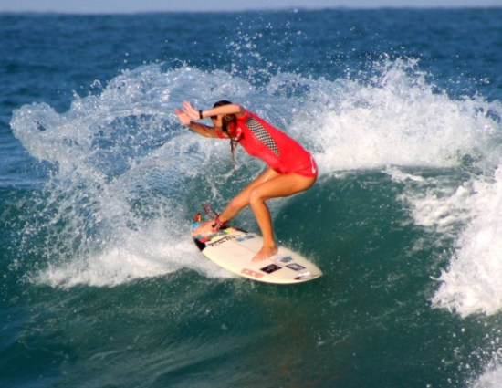 Chelsea Roett on the surf in Los Cabos, Mexico.