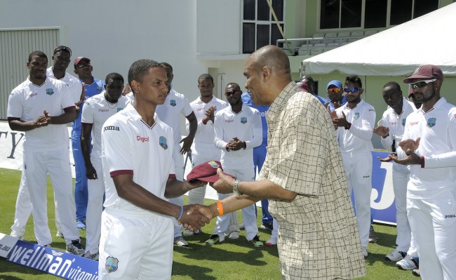Debutant Shane Dowrich receiving his cap from former Dominica and West Indies fast bowler Norbert Phillip.