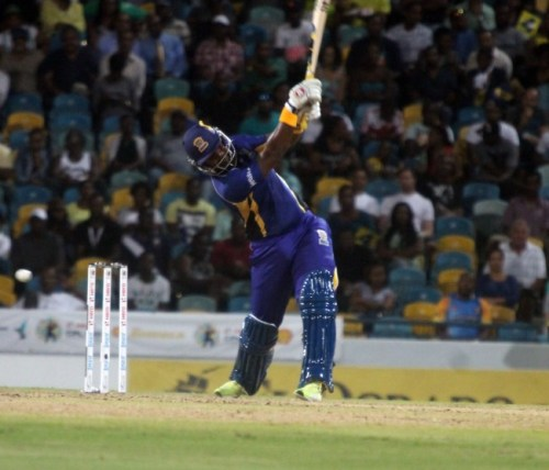 Dwayne Smith essays a big drive during his half-century.