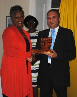 Trustee for the Maria Holder Trust, Mary Brewster (left), receiving that organization's award from Douglas Rotchell.