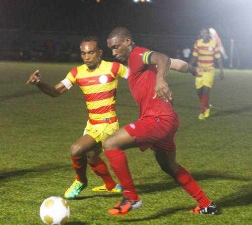 Rendezvous midfielder Romano Snagg (left) takes on Brittons Hill Captain Omar Archer.