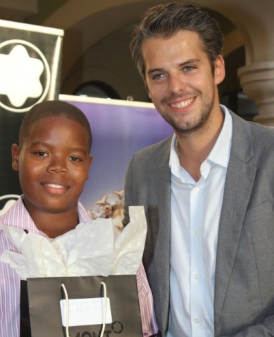 Top Boy of the 11-Plus Dante Small posing with Florian Boiteux representative of Mont Blanc Mexico, the Caribbean and Latin America.