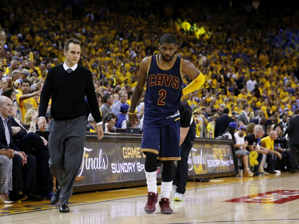 OAKLAND, CA - JUNE 04:  Kyrie Irving #2 of the Cleveland Cavaliers leaves the game injured against the Golden State Warriors during Game One of the 2015 NBA Finals at ORACLE Arena on June 4, 2015 in Oakland, California. NOTE TO USER: User expressly acknowledges and agrees that, by downloading and or using this photograph, user is consenting to the terms and conditions of Getty Images License Agreement.  (Photo by Ezra Shaw/Getty Images)