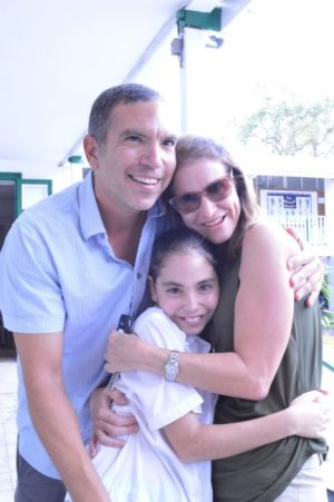 Top student Jemma Evelyn (centre) being embraced by her happy parents Zary (left) and Kristina.