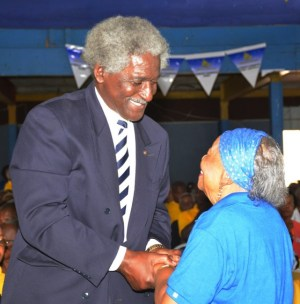 US Ambassador to Barbados Larry Palmer greeting Dame Maizie Welch-Barker at the DLP annual conference.