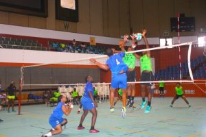 Collin Thomas of Enforcers being blocked by Deacons who won in straight sets at the Caribbean Food and Volleyball Festival. (Pictures Morissa Lindsay)