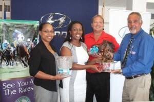 Courtesy Garage sales manager Philip Bynoe (right) presents (from left) BTC's chief executive officer Rosette Peirce and sales and marketing executive Sandra Corbin, as well as the BTBA's Jonathan Simpson with the trophies for the event.