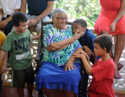 Centenarian Helen Lizetta Hutchinson showing some love and care to great-grands.