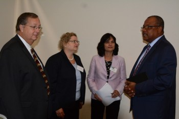 Minister of Health John Boyce (right) speaking with (from left) Chris Cushing, Laura Griesmer and Suneeta Sharma at the End-of-Project event for the Caribbean Regional Health Policy Project.