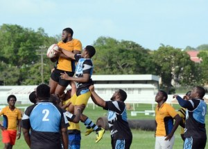 Enrique Oxley (in yellow, with the ball), wins the lineout for Emperors, despite the efforts of Scorpions' Wayne Scantlebury.