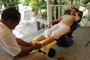 Steve Barnett focusing on applying reflex massage to Desiree Walcott's toe.