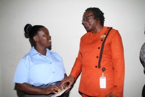 Desiree Brathwaite, who received a Grade 2 in CXC electronic document preparation management, receiving congratulatory words of advice from Cheryl Forde, Cooperators General Insurance human resources marketing manager, with whom she did  her summer internship.