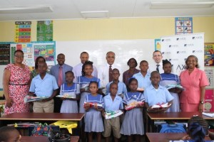 Students of Deacons Primary, along with school officials,  the Axcel Finance team and Minister of Finance Chris Sinckler.