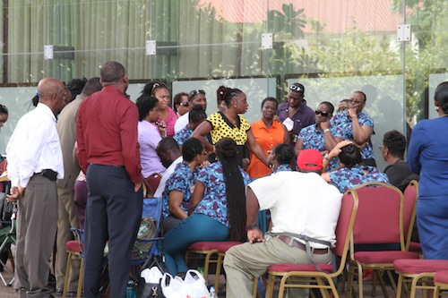 BWU General Secretary Toni Moore (in yellow shirt) speaking to Central Bank employees today.