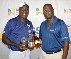 Ivan Codrington (left) won the senior men's division and accepted his prize from BGA secretary Trenton Weekes.