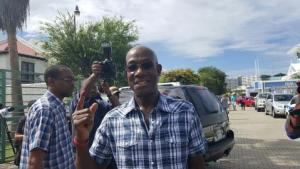 Leader of the PNM Dr Keith Rowley casts his vote at the International School, Westmoorings.