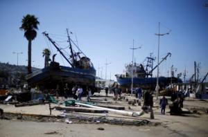 Ships are seen on the street after an earthquake hit areas of central Chile, in Coquimbo city, north of Santiago, Chile, today.