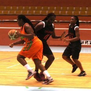 Tiffany Husbands dribbles past Challengers' defence.