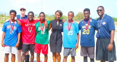 (L-R) Nick Hoyte, coach Becky Bonner, Zachary Moore, Joshua Lowe, Digicel marketing manager Krystal
